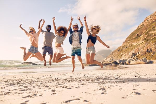 group-of-friends-having-fun-on-beach